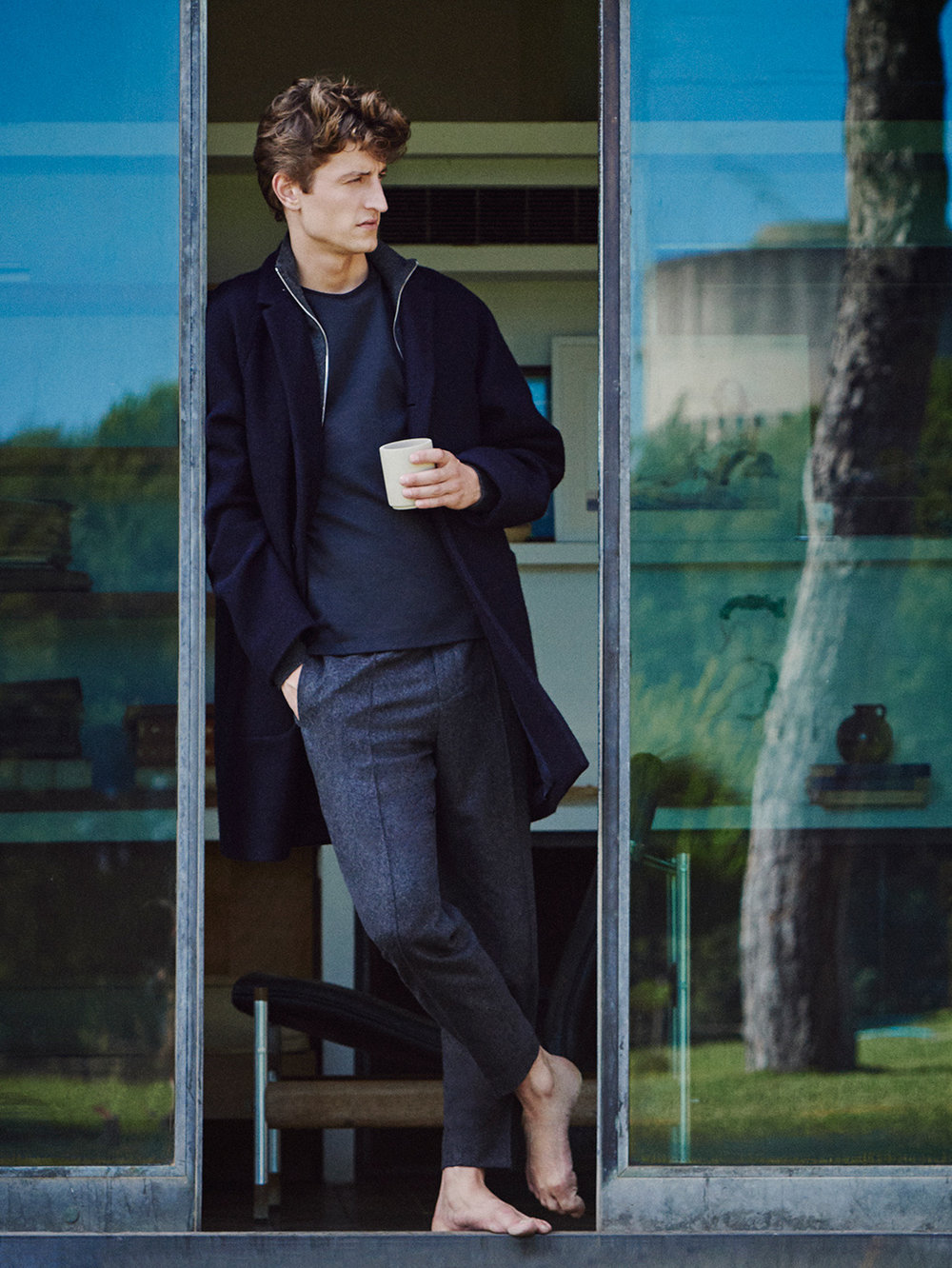 Oversized wool coat, £225 High-neck zip-up cardigan, £59 Round-neck T-shirt, £29 Trousers with elastic waist, £79
