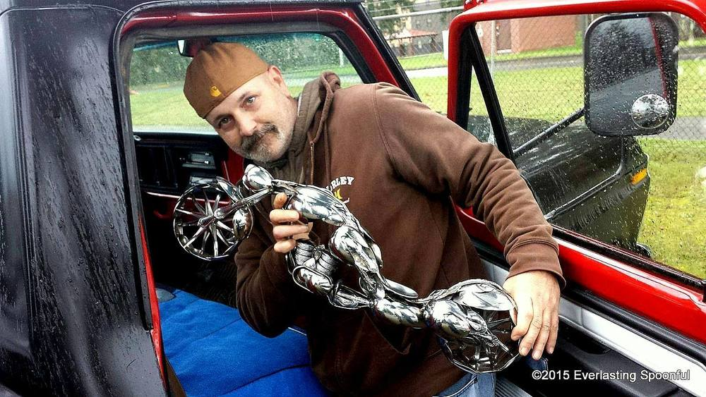 "Artist James Rice, with his spoon motorcycle sculpture ""The Wasp"""