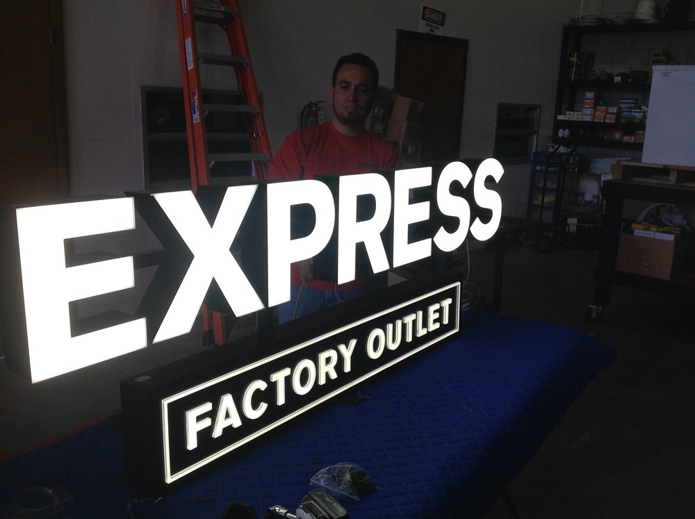 sign installation - express factory outlet.JPG