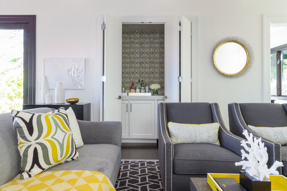 gray, white and yellow media room with wet bar