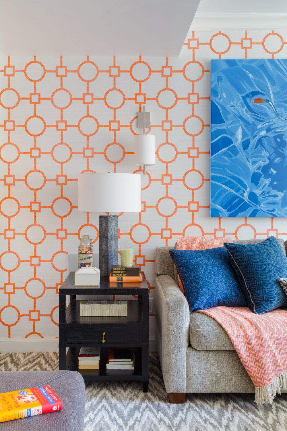 family room with vibrant orange wallpaper