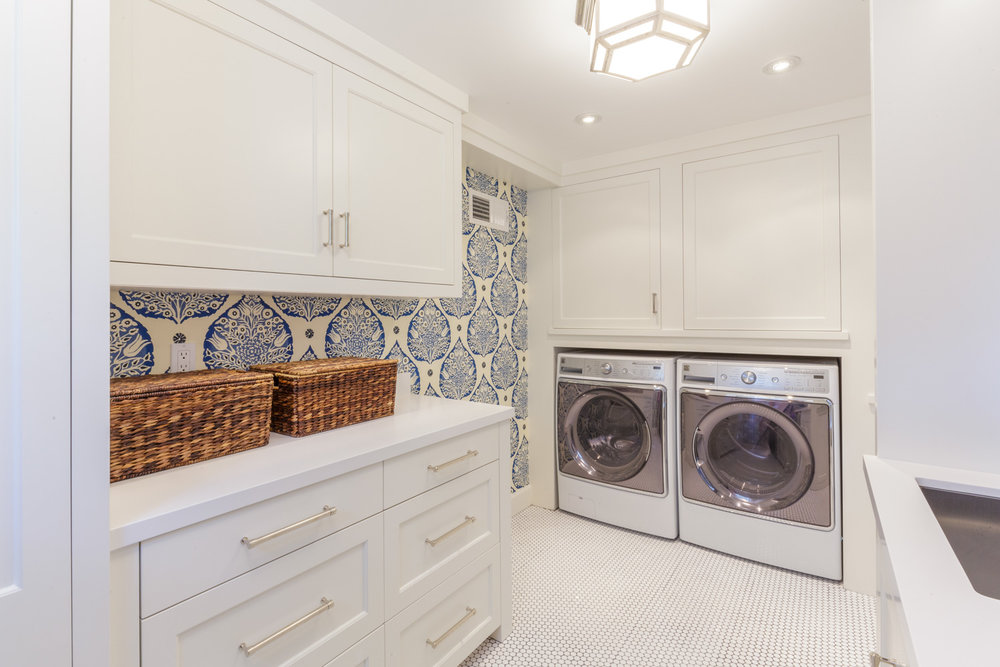 white laundry room with graphic wallpaper