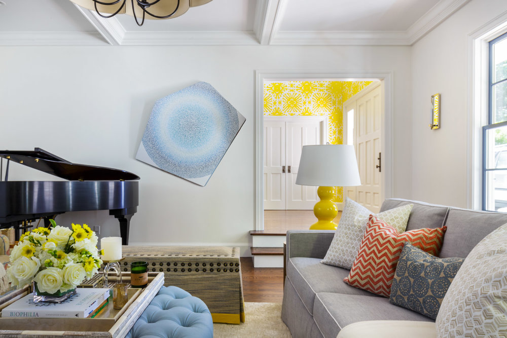 neutral living room with yellow accents