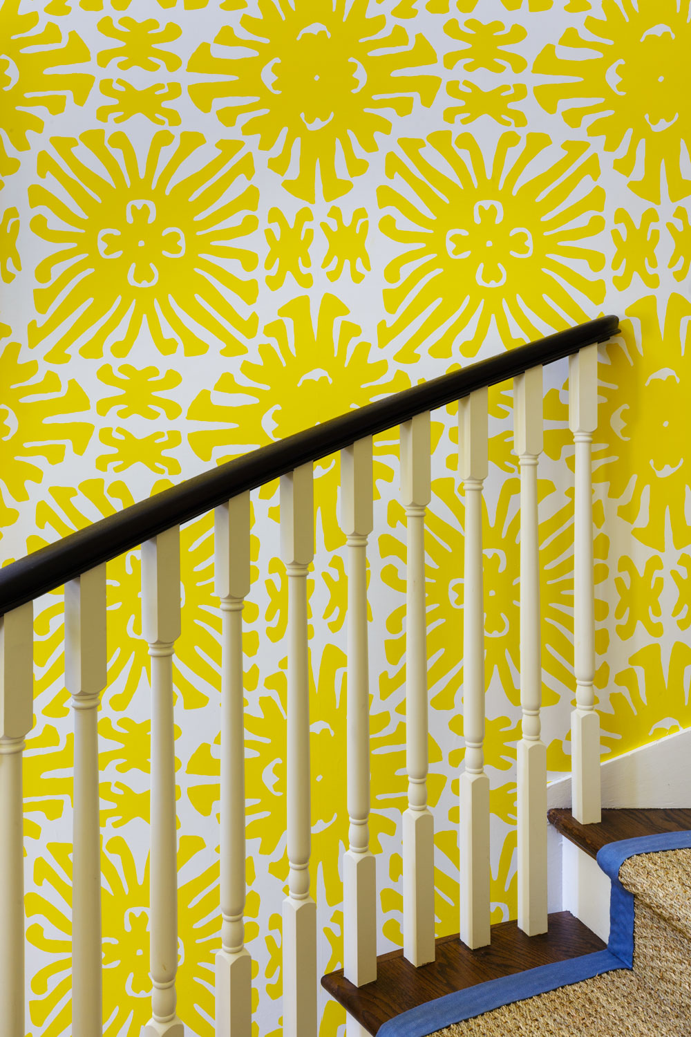 staircase with yellow wallpaper