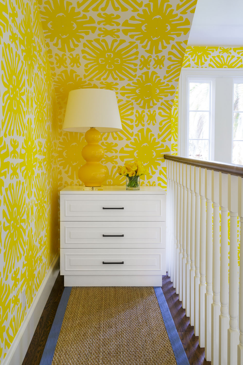 hallway with yellow wallpaper