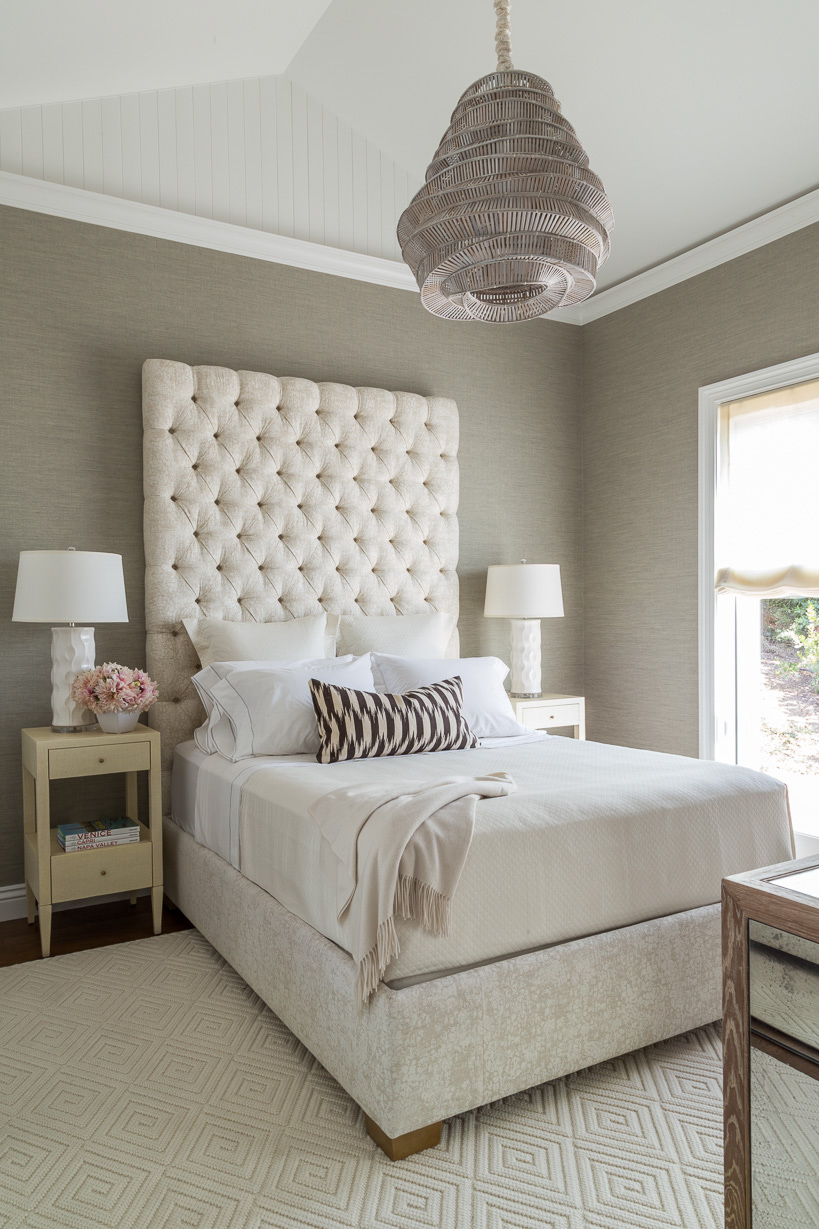 feminine guest bedroom with tufted headboard