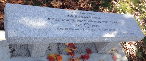 Bench located at the gazebo on the Holliston Rail Trail Given by the Marcoux Family