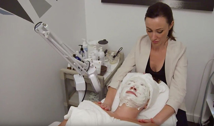 Smith and Brit co-founder Kristyn Smith conducting a facial at her New York Boutique.