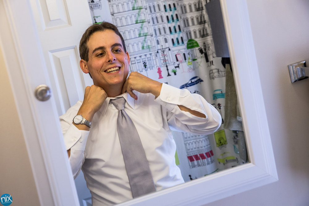 groom-getting-ready-mirror.jpg