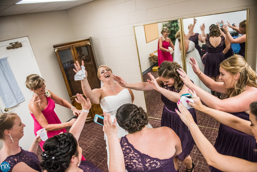 bride-bridemaids-laughing-ceremony.jpg