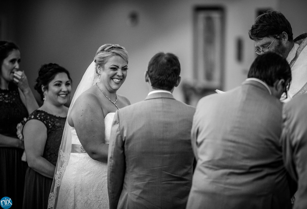 catholic ceremony bride laughs.jpg