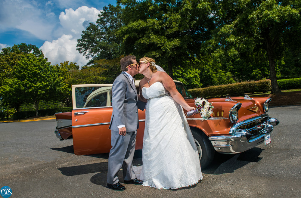 bride groom kiss classic car.jpg
