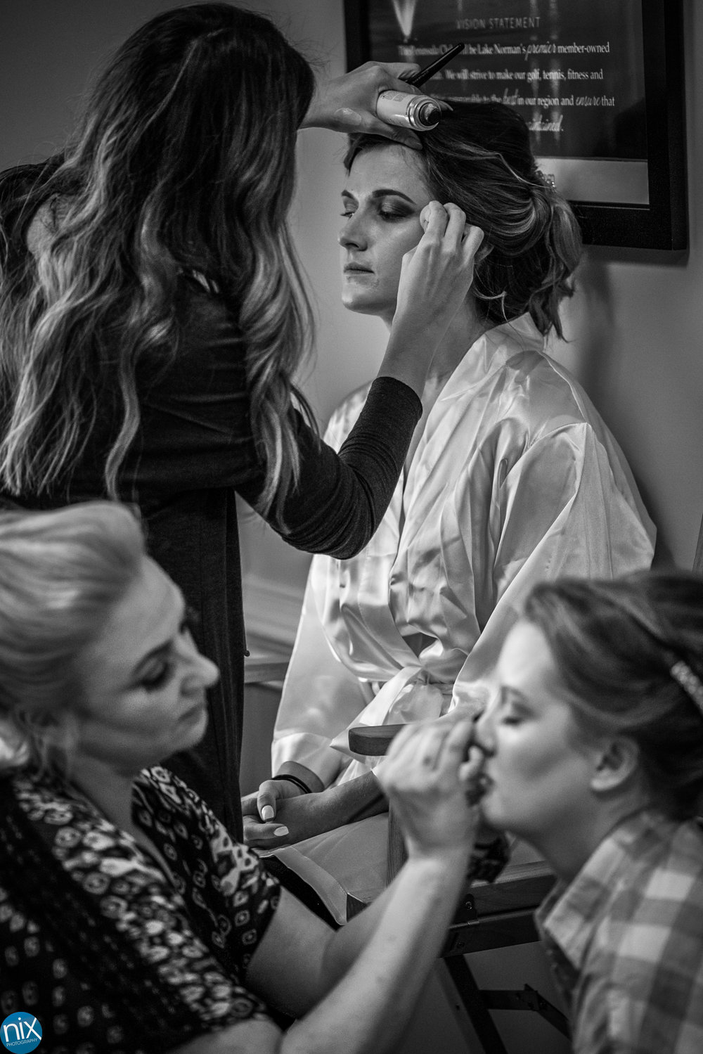 bride getting ready peninsula club .jpg