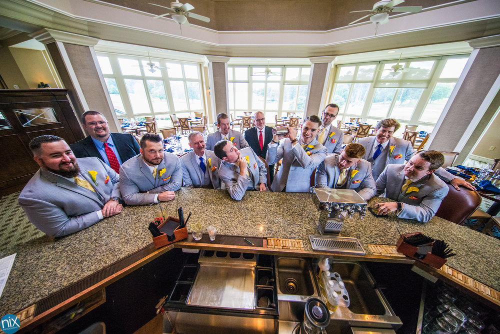groom at bar with groomsmen.jpg