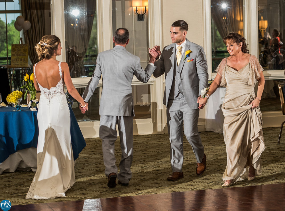 father high fives groom bride dance.jpg