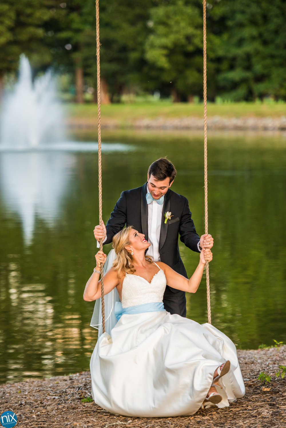 View At Emerald Lake bride and groom swing.jpg