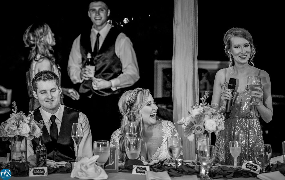 bride laughs during maid of honor speach.jpg