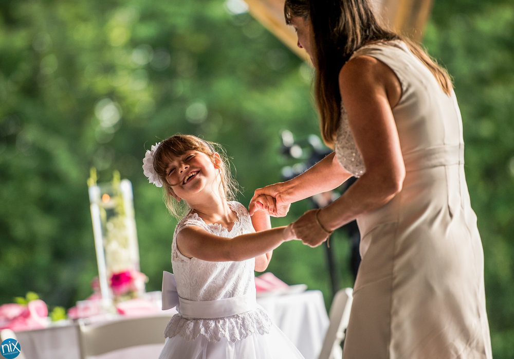 flower girl dances during reception at cabin ridge.jpg