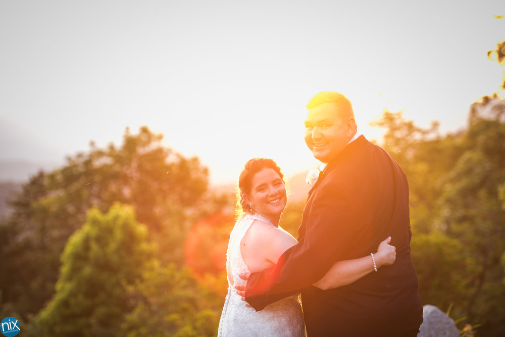bride and groom at sunset cabin ridge.jpg