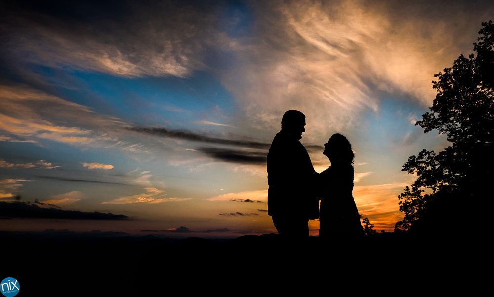 bride and groom silhouette at sunset at cabin ridge.jpg