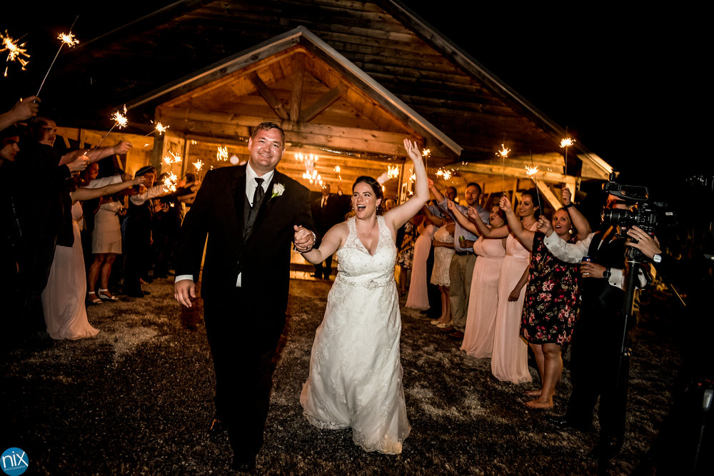 bride and groom sparkler exit at cabin ridge.jpg
