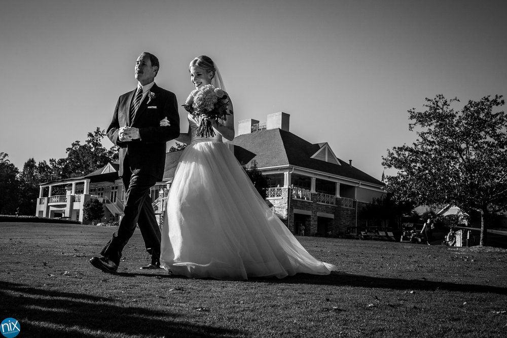 father walks bride diown aisle North Stone Country Club in Huntersville.jpg