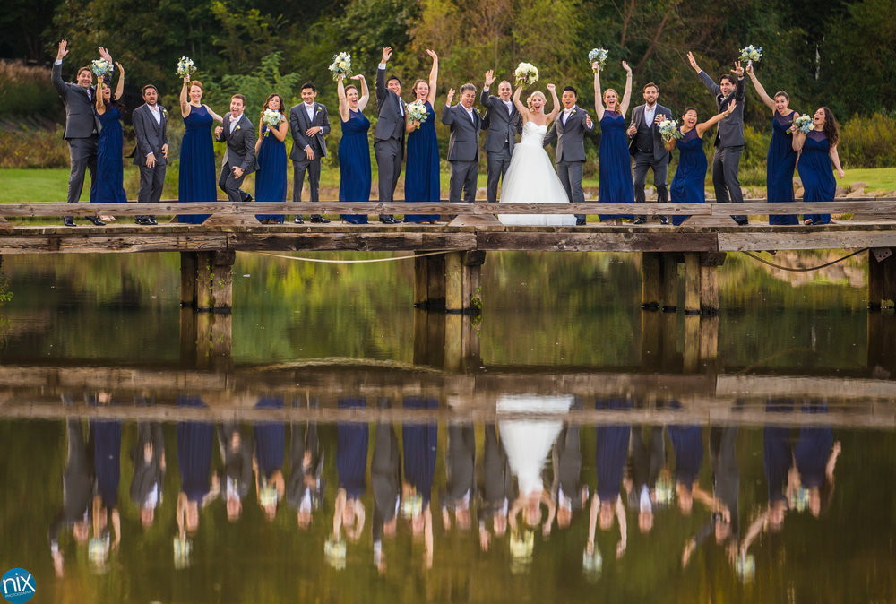 wedding party on a bridge at North Stone Country Club in Huntersville.jpg
