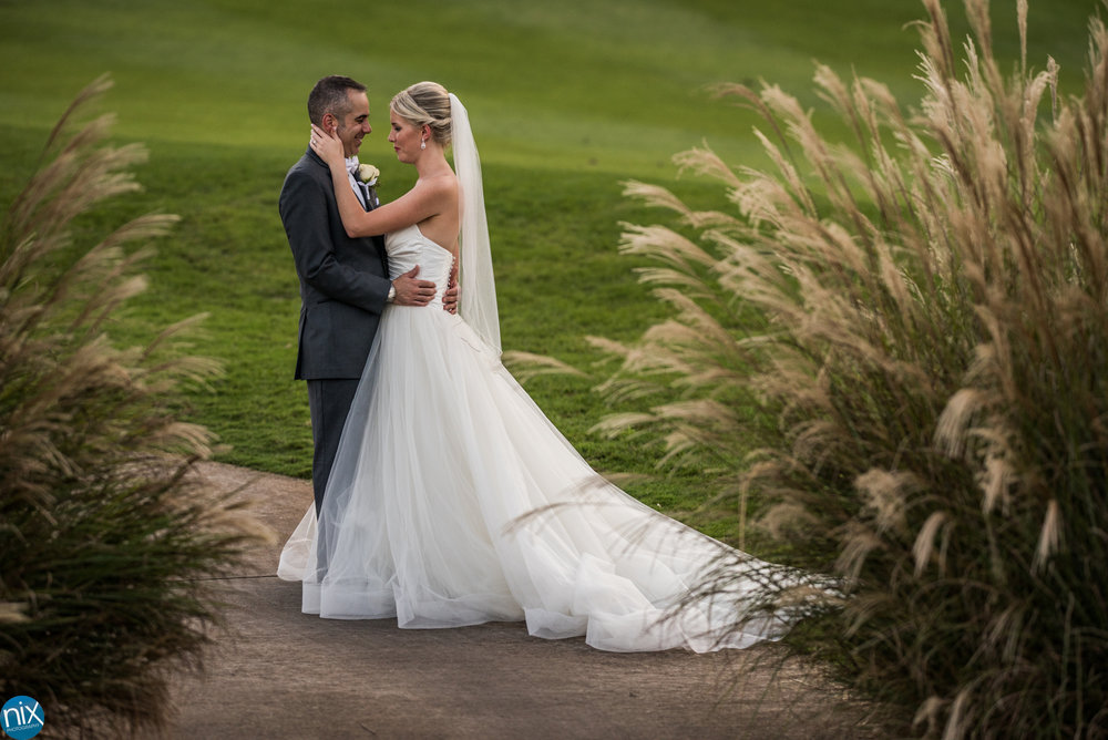 bride and groom on golf course at North Stone Country Club in Huntersville.jpg