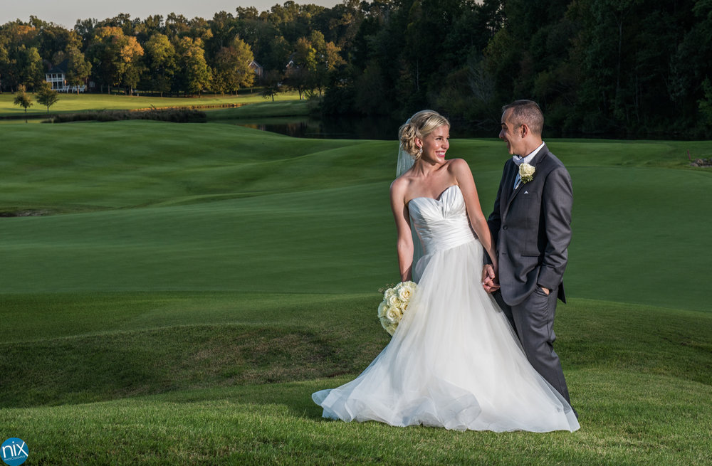 bride and groom on golf course at sunset North Stone Country Club in Huntersville.jpg