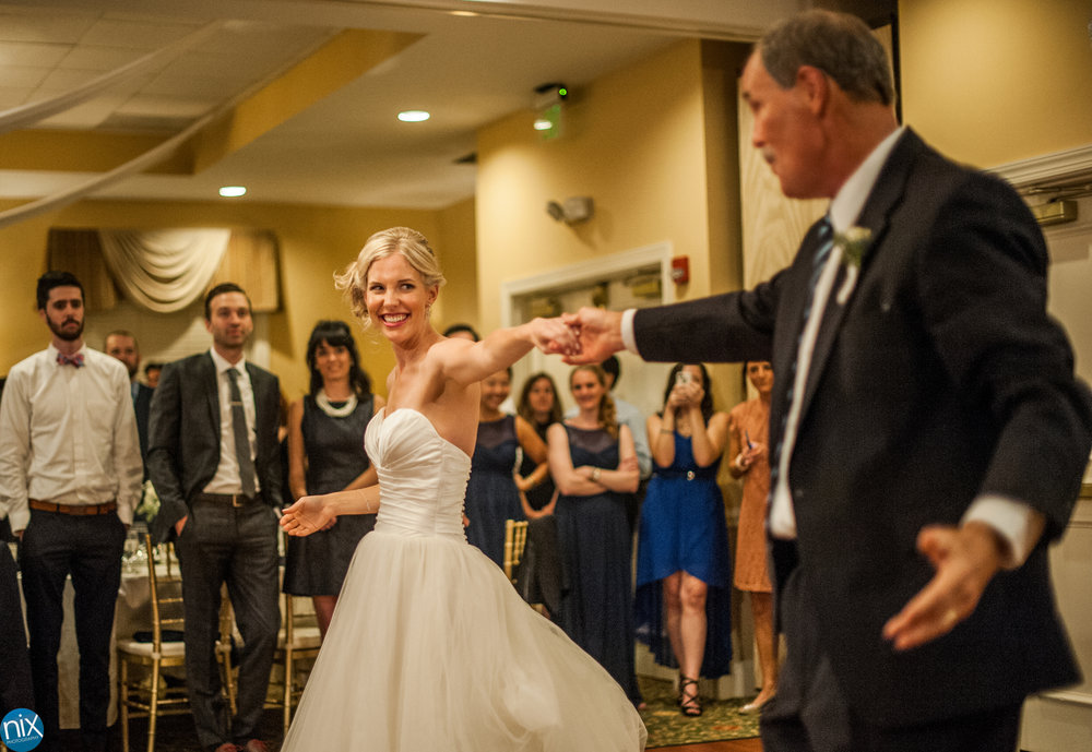 bride dances with father at North Stone Country Club in Huntersville.jpg