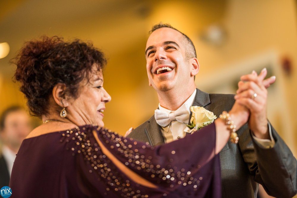 groom dances with mother at North Stone Country Club in Huntersville.jpg