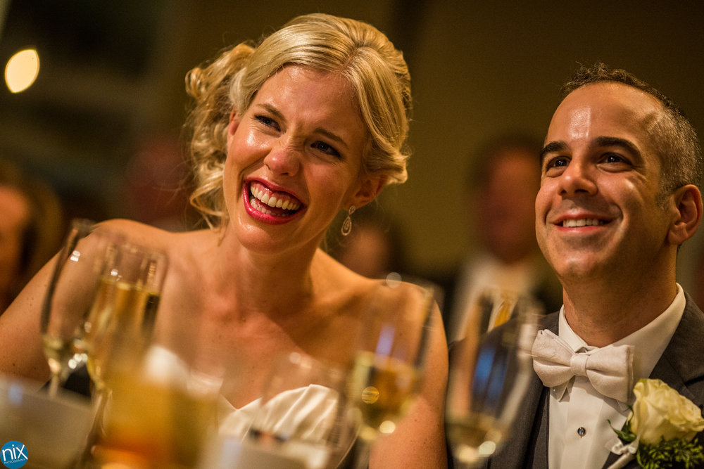 bride laughs during toasts at North Stone Country Club in Huntersville.jpg