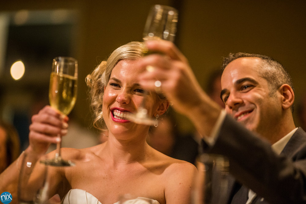 bride and groom toast at North Stone Country Club in Huntersville.jpg