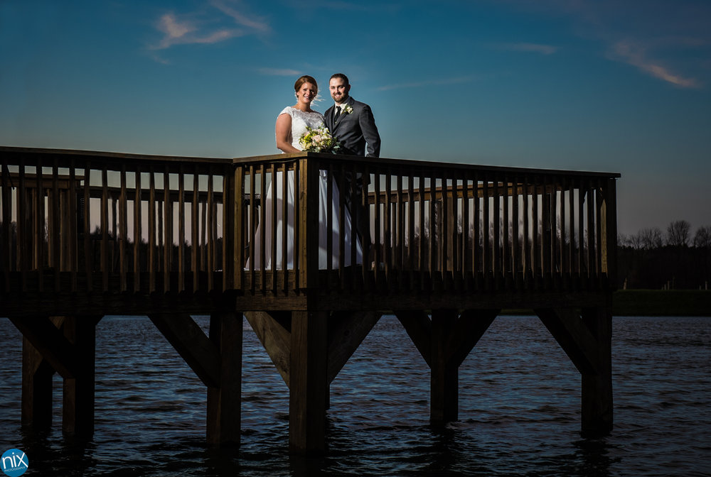 bride-and-groom-on-dock-childress-vineyards.jpg