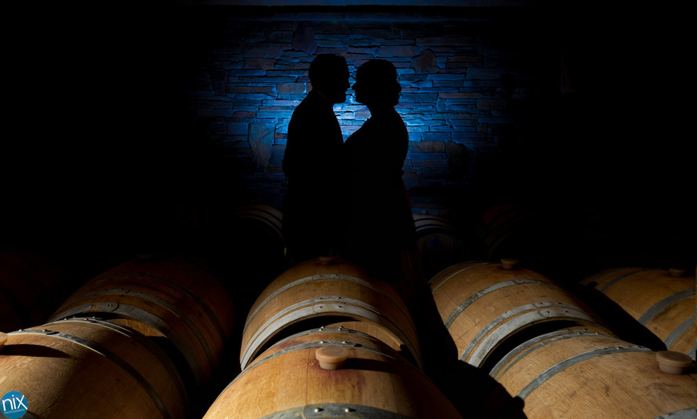 bride-and-groom-silhouette-barrel-cave-childress-vineyards.jpg