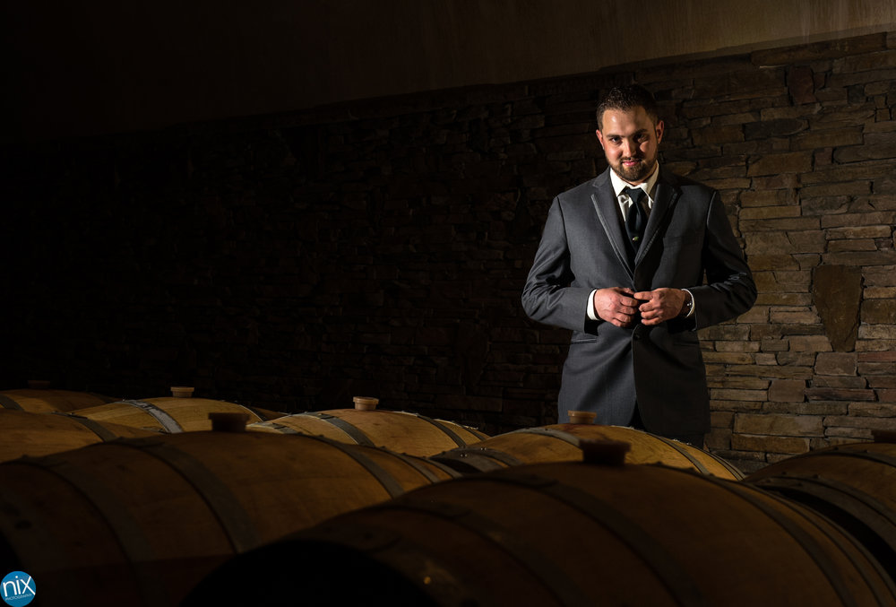 groom-in-barrel-cave-childress-vineyards.jpg