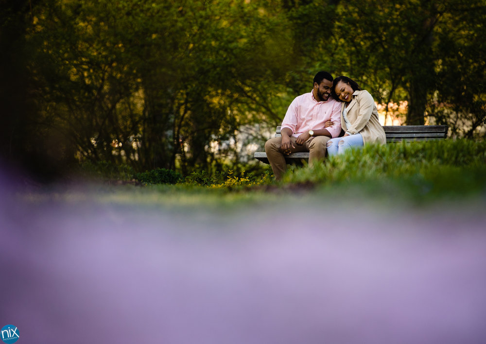 couple-sits-on-bench-Arboretum-engagement-photography.jpg