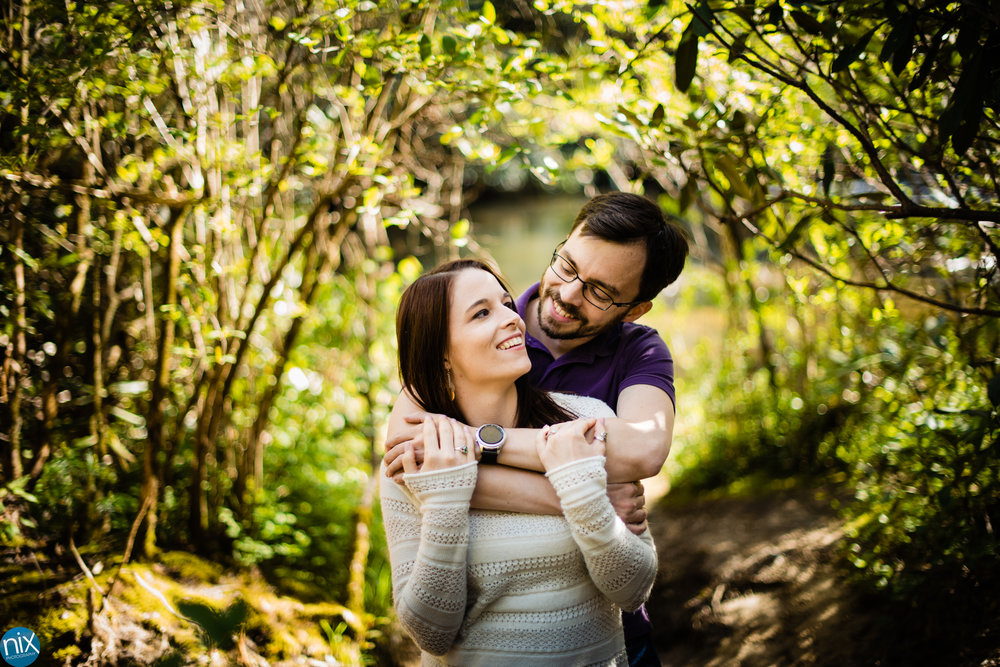 couple-hugging-in-forest-engagement.jpg