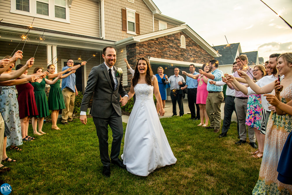 bride_groom_sparkler_exit_house.jpg