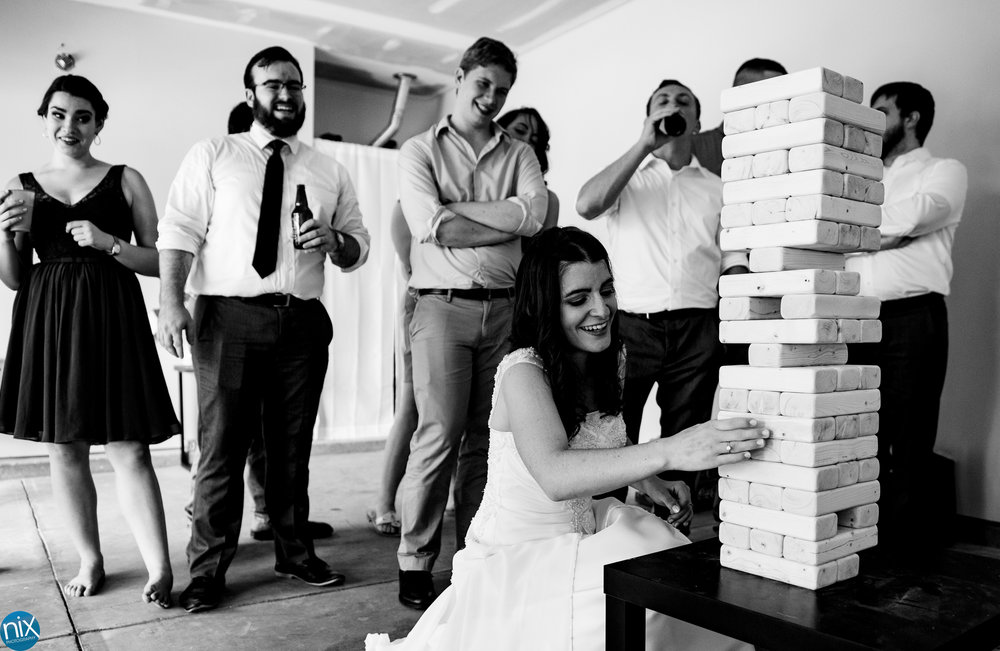 bride_plays_jenga_rock_hill_wedding.jpg