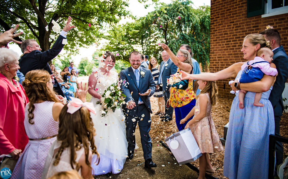 flowers_thrown_on_bride_and_groom.jpg