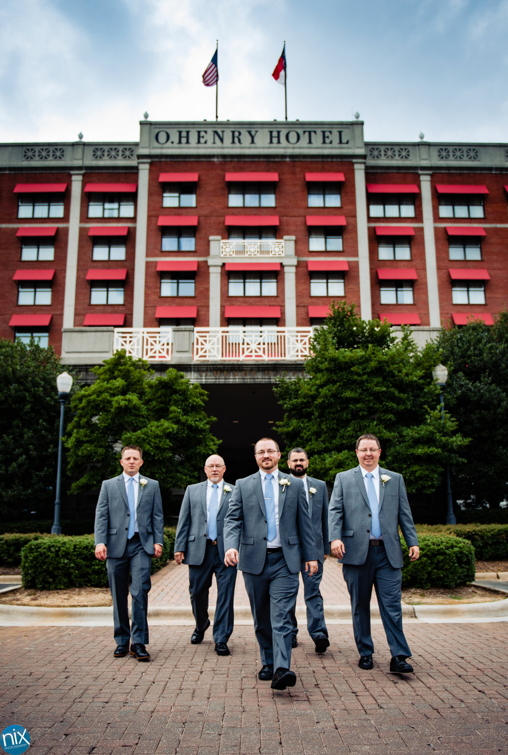 groom_and_groomsmen_ohenry_hotel.jpg