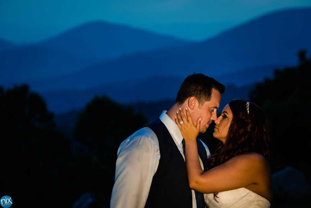 bride and groom kiss at sunset blur ridge mountains.jpg