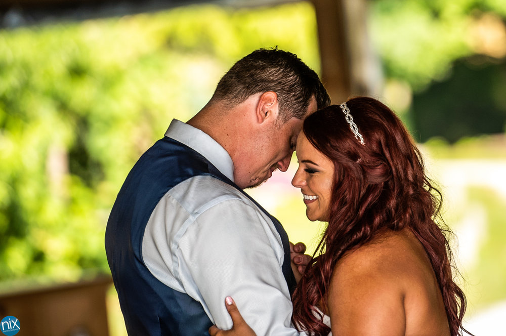 groom reacts during first dance at the cabin ridge.jpg