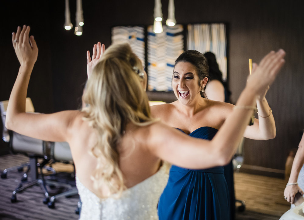 bridesmaid-cheers-with-bride-ebassy-suites-charlotte.jpg