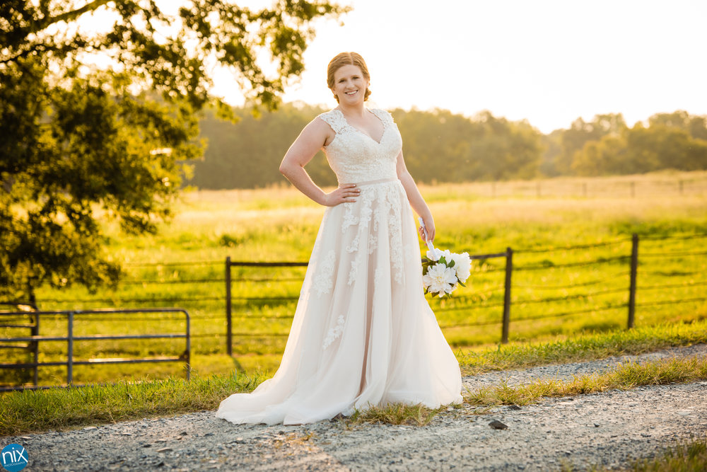 bridal photos with farm pasture in backgroud.jpg