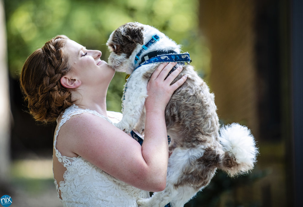 bride with dog before wedding.jpg