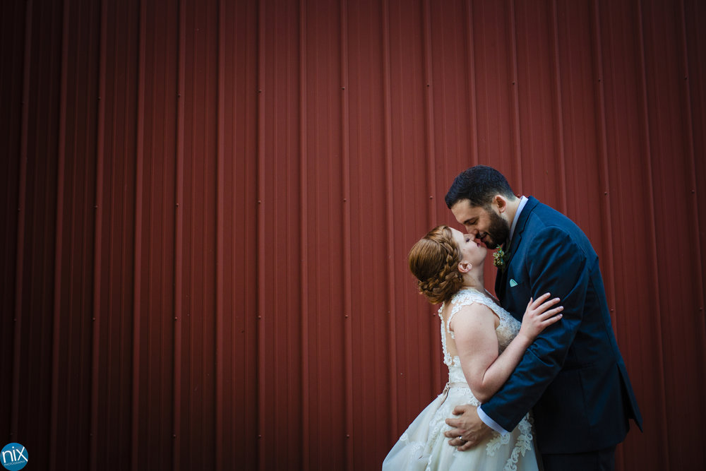 red barn bride and groom kiss.jpg