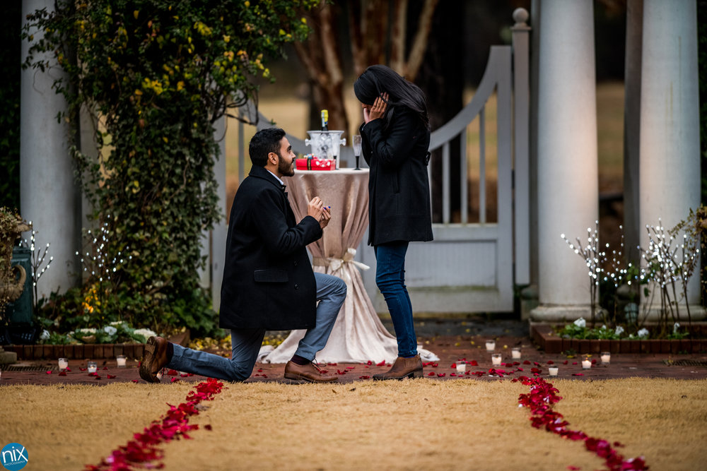 """She said """"Yes"""" - Looking for a romantic place to propose to the love of your life? Daniel Stowe Botanical Gardens might be the perfect place, and they'll even help you up your game with some rose pedals and champaign!There are many spots you can stop to pop the question.Take a look at their engagement packages."""
