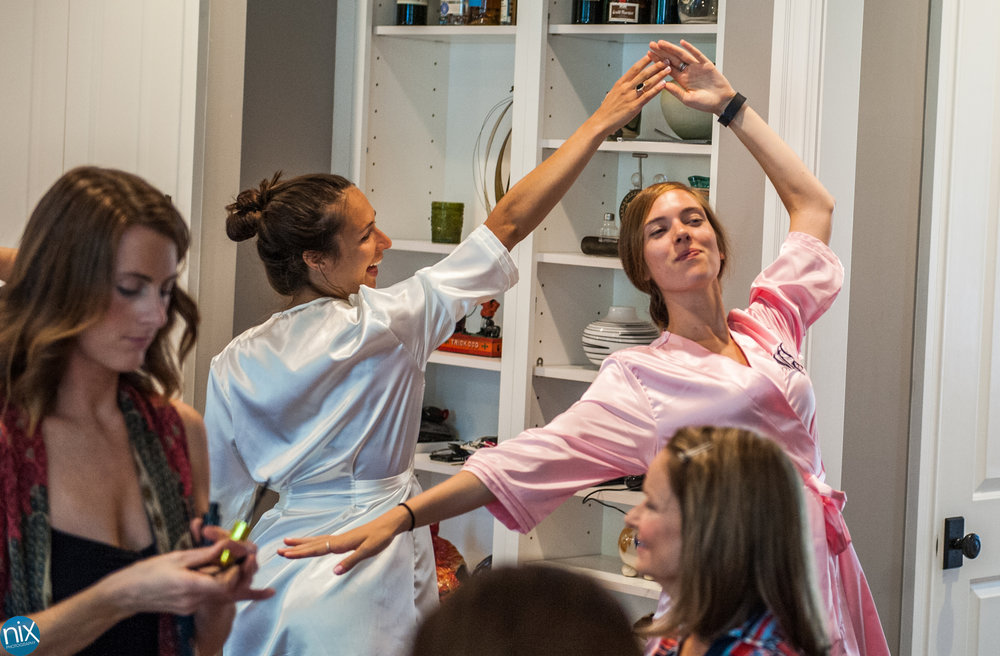 bridemaids dance while getting ready for wedding.jpg